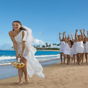 Jamaica Honeymoon Packages Breathless Montego Bay Resort & Spa Bride On Beach Throwing Bouquet