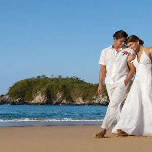Mexico Honeymoon Packages Secrets Huatulco Resorts & Spa Couple On Beach Wedding