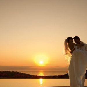 Mexico Honeymoon Packages Secrets Huatulco Resorts & Spa Sunset Couple Wedding