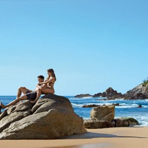 Mexico Honeymoon Packages Secrets Huatulco Resorts & Spa Couple On Rock On Beach