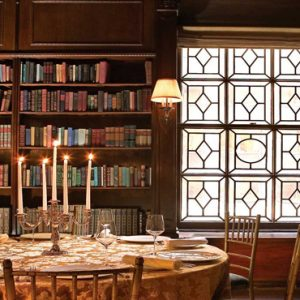 New York Honeymoon Packages Lotte New York Palace Candlelight Dinner Setup Near Bookcase