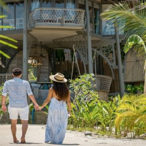 Phuket Honeymoon Packages TreeHouse Villas Couple Walking Outside Villa