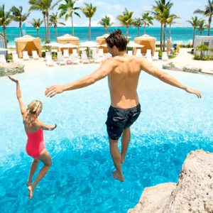 Bahamas Honeymoon Packages Grand Hyatt Baha Mar Couple Jumping In Pool