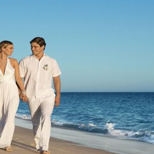Mexico Honeymoon Packages Secrets Puerto Los Cabos Golf & Spa Resort Bride And Groom On Beach