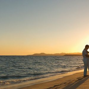 Mexico Honeymoon Packages Secrets Puerto Los Cabos Golf & Spa Resort Bride And Groom On Beach At Sunset