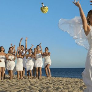Mexico Honeymoon Packages Secrets Puerto Los Cabos Golf & Spa Resort Bride Throwing Bouquet