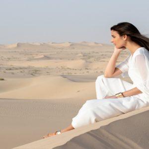 Abu Dubai Honeymoon Packages Jumeirah Al Wathba Woman On Desert