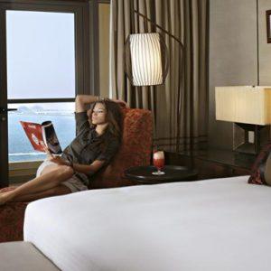 Dubai Honeymoon Packages Amwaj Rotana Woman By Bed