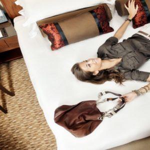 Dubai Honeymoon Packages Amwaj Rotana Woman On Bed