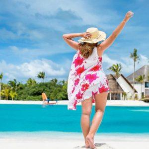 Maldives Honeymoon Packages Varu By Atmosphere Women On Beach