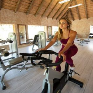 Woman In Gym Kapama Private Game Reserve South Africa Honeymoons
