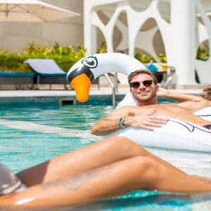 Couple In A Pool V Hotel Dubai, Curio Collection By Hilton Dubai Honeymoons