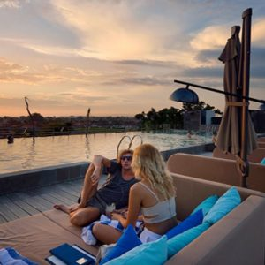 Couple Relaxing By Rooftop Pool De Vins Sky Hotel Seminyak Bali Honeymoons