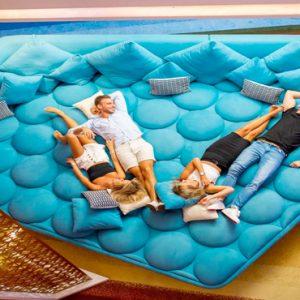 Couples Lounging V Hotel Dubai, Curio Collection By Hilton Dubai Honeymoons